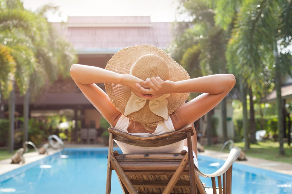 woman relaxing after the pool service in Stuart